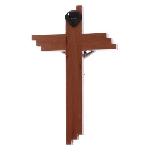 Crocifisso moderno in legno di pero seghettato 12 cm con corpo metallico 2