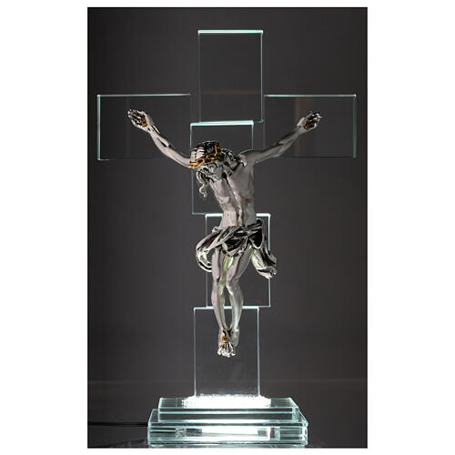 Modern crystal crucifix with metal body of Christ and light 2