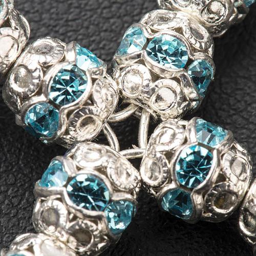 Cruz de plata con strass azul celeste 3