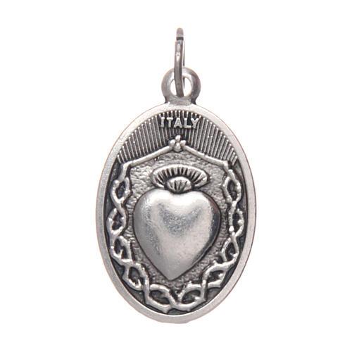 Medalla de Niño Jesús de Praga en metal ovalada 20 2