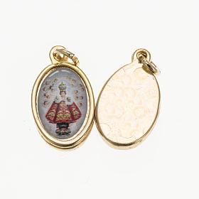 Medals: Medal in golden metal, resin baby Jesus of Prague 1.5x1cm