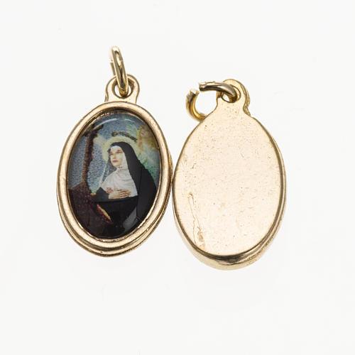 Medalla S. Rita en metal dorado y resina 1,5x1cm 1