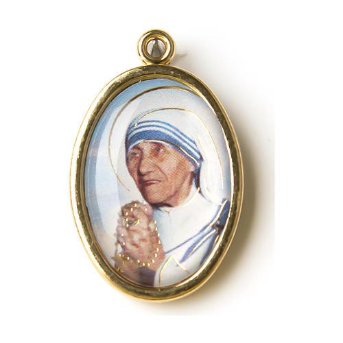 Saint Teresa of Calcutta medal in golden metal with resin image 1