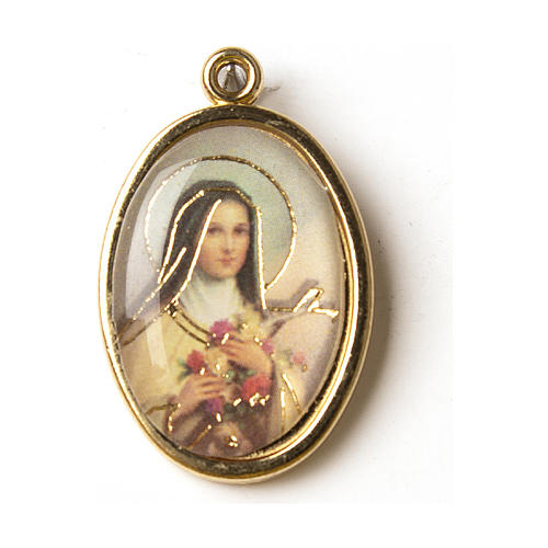Golden medal decorated with resin image of Saint Teresa 1
