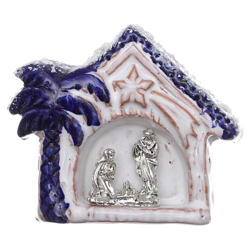 Magnete capannina innevata con palma blu con Natività terracotta Deruta 1