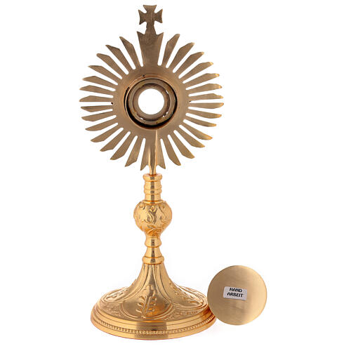Gold plated brass reliquary with decorated node and rays frame h 11 in 5