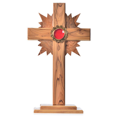 Reliquary in olive wood with rays H29cm, display in golden meta 1
