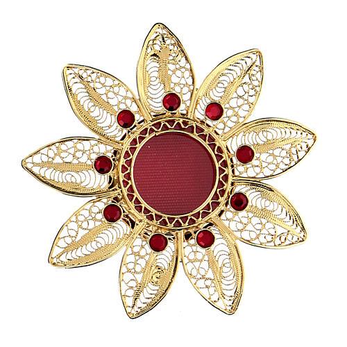 Relicario 5 cm en forma de flor plata dorada piedras rojas 1
