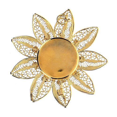 Relicario 5 cm en forma de flor plata dorada piedras rojas 2