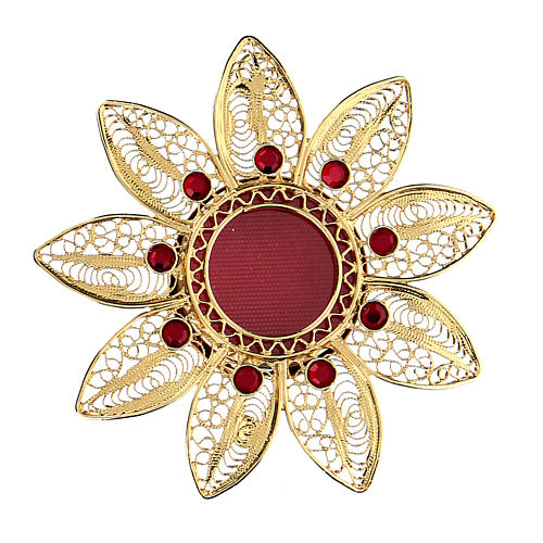 Reliquiario 5 cm a forma di fiore argento dorato pietre rosse 1