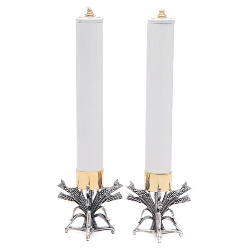 Pareja candeleros peltre plateado con vela 1