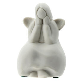 Seated angel 2 1/4 in white porcelain s1