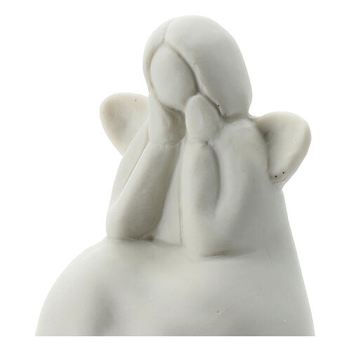 Seated angel 2 1/4 in white porcelain 2