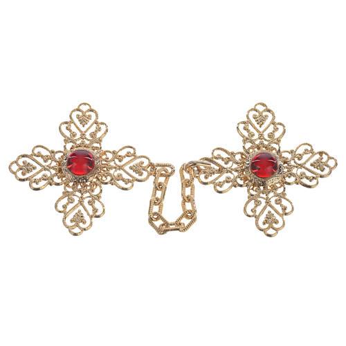 Broche pluvial cruz dorada piedra roja 1