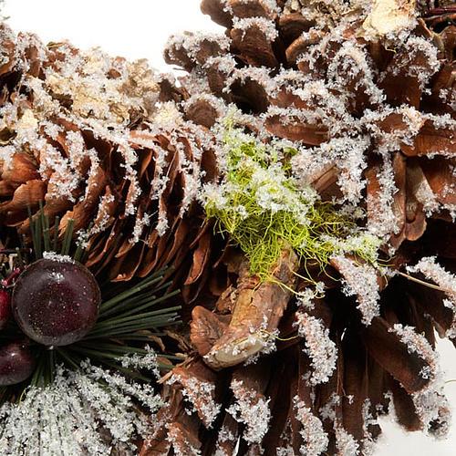 Corona natalizia pigne e neve addobbo natalizio 2