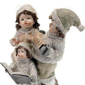 Statuetta trio bambini cantori addobbi natalizi s3
