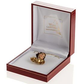 Cabecita de un ángel con alas de oro en caja de madera s1