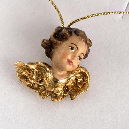 Cabecita de un ángel con alas de oro en caja de madera 2