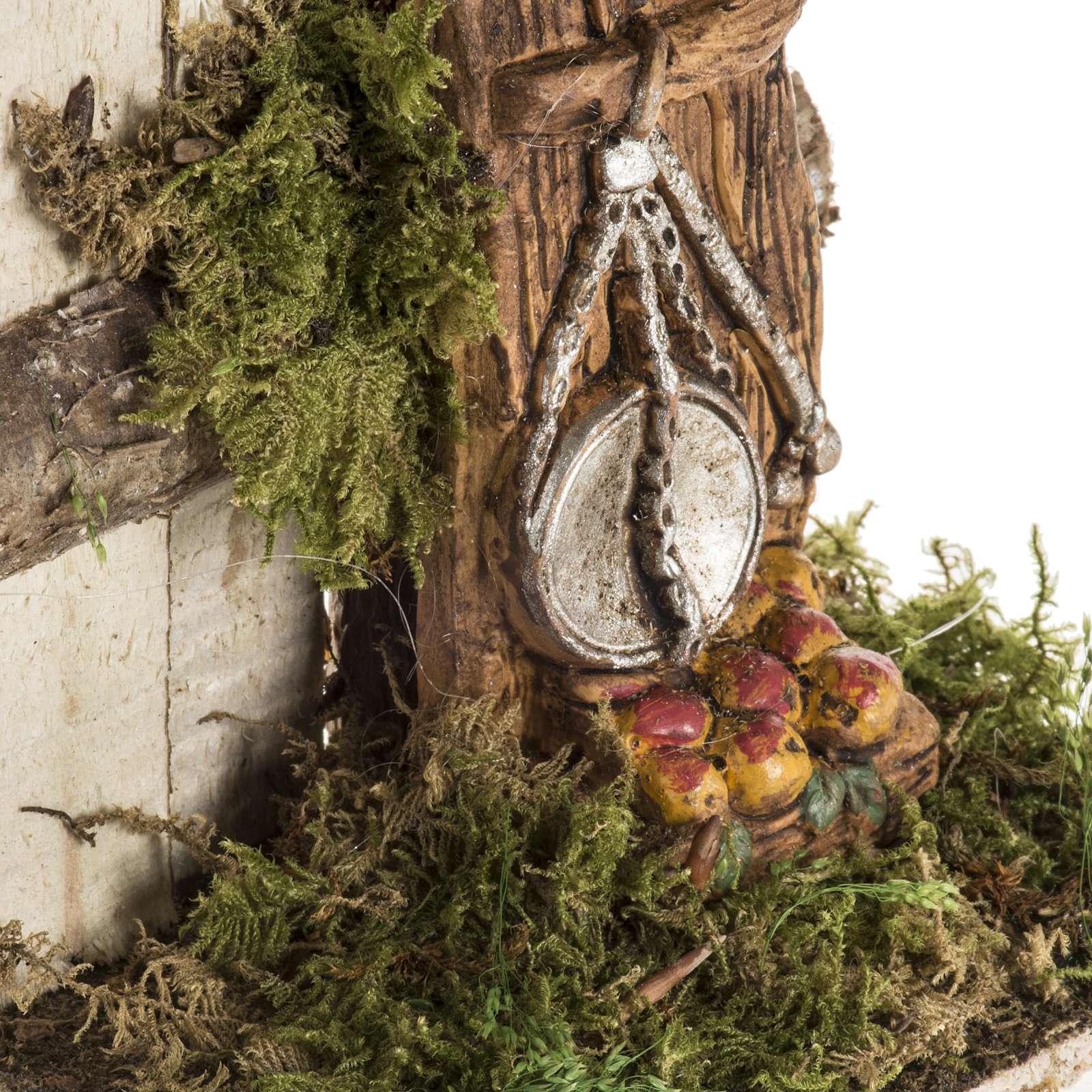 Milieu crèche Noel avec troncs et balance 4