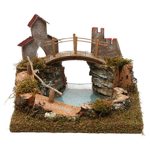Lago de montaña con puente y animales 1