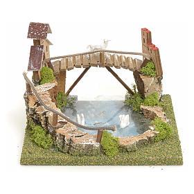 Laghetto di montagna con ponte e animali s1
