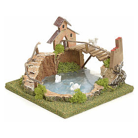 Laghetto di montagna con ponte e animali s2