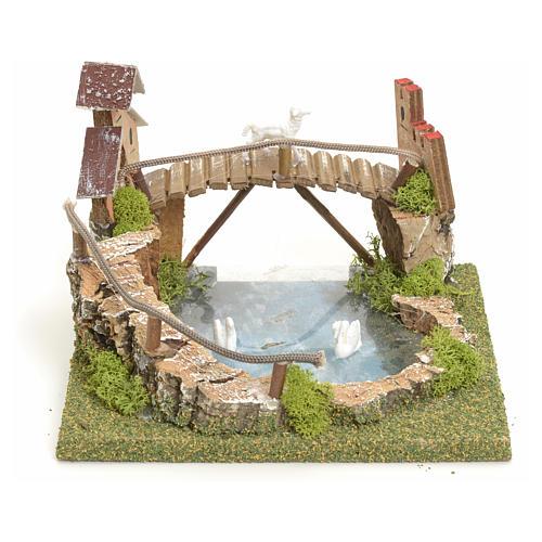 Laghetto di montagna con ponte e animali 1