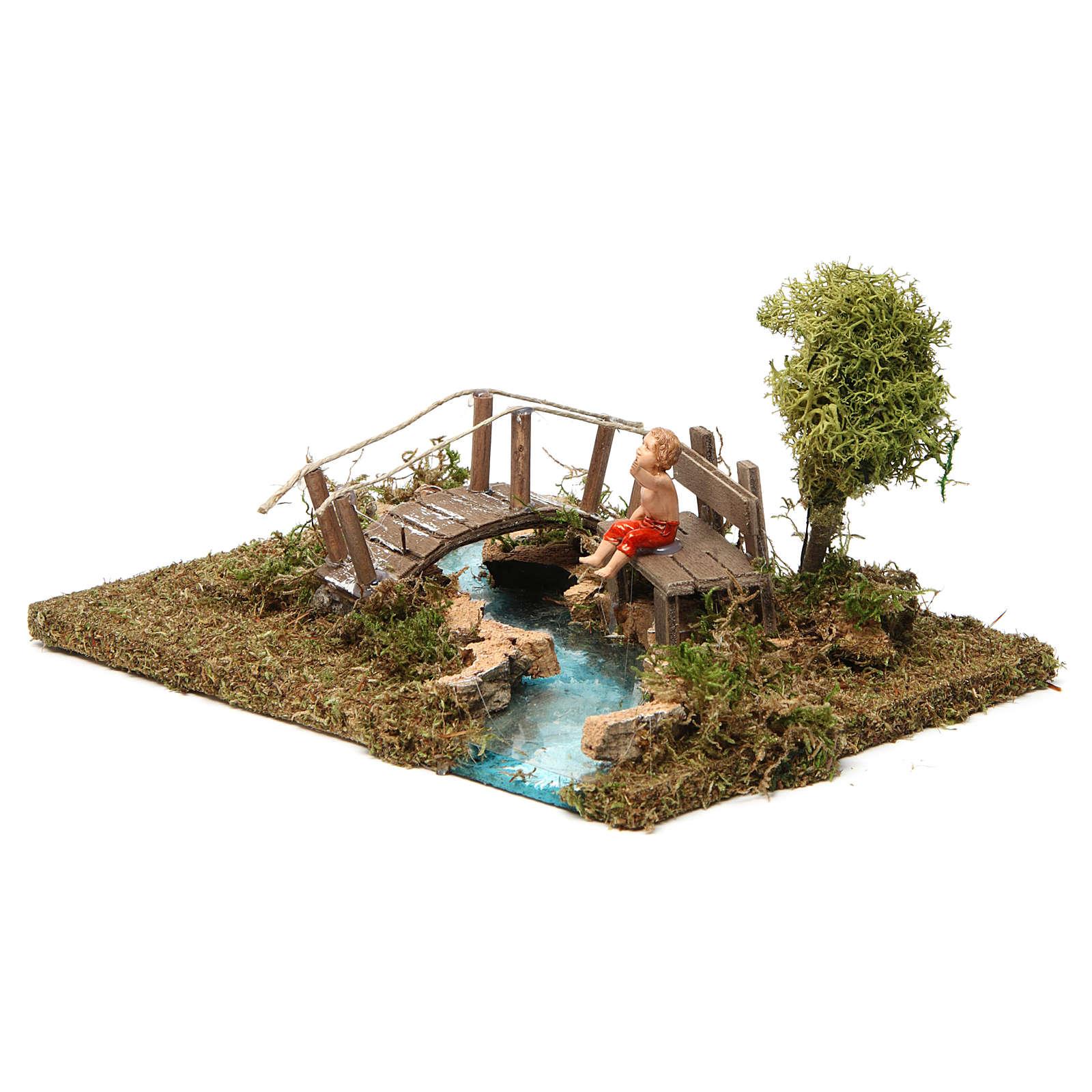 Ponte su fiume con bimbo seduto 4
