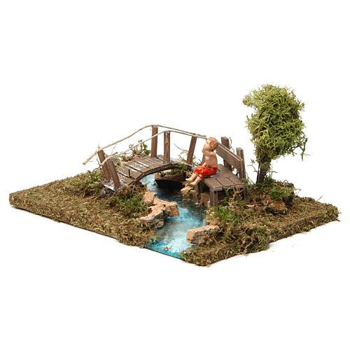 Ponte su fiume con bimbo seduto 2