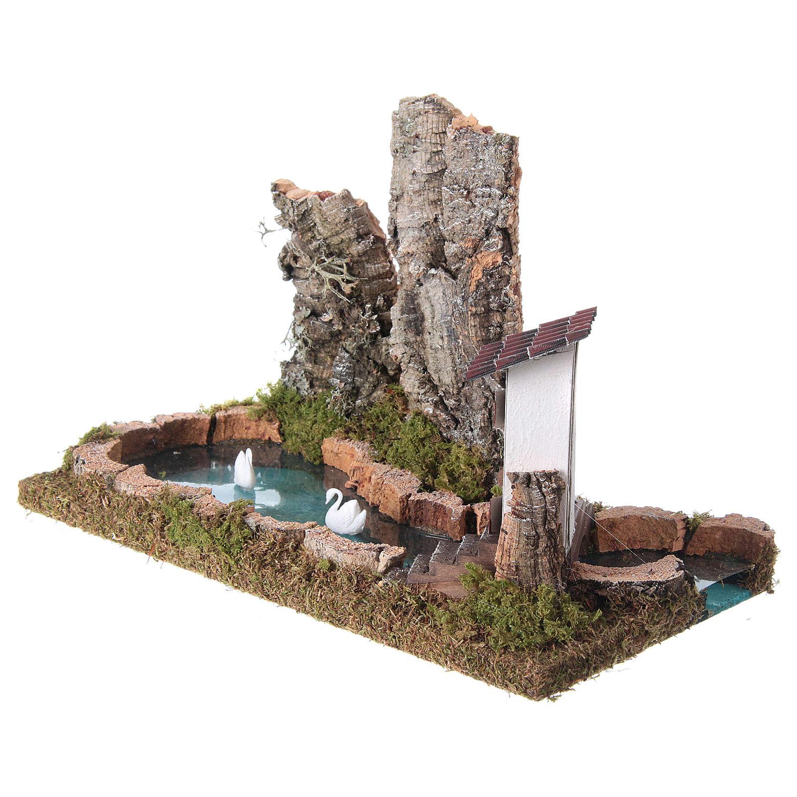 Lago pesebre con rocas y cisnes 4