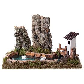 Lago pesebre con rocas y cisnes s1