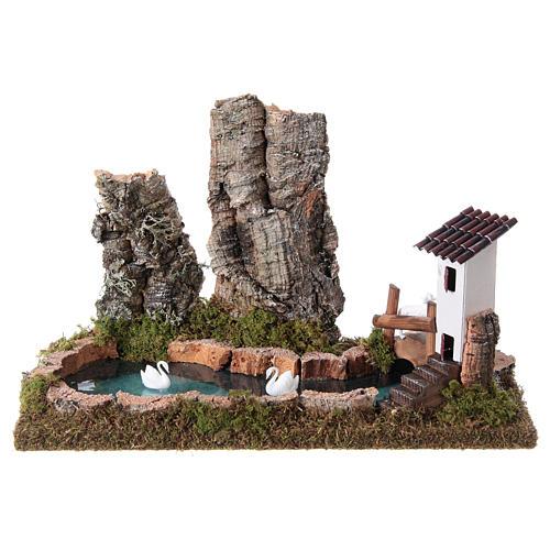 Lago pesebre con rocas y cisnes 1