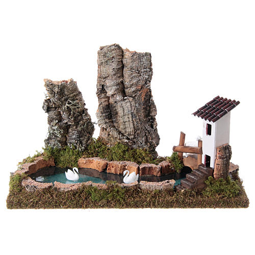 Nativity setting, pond with rocks and swans 1