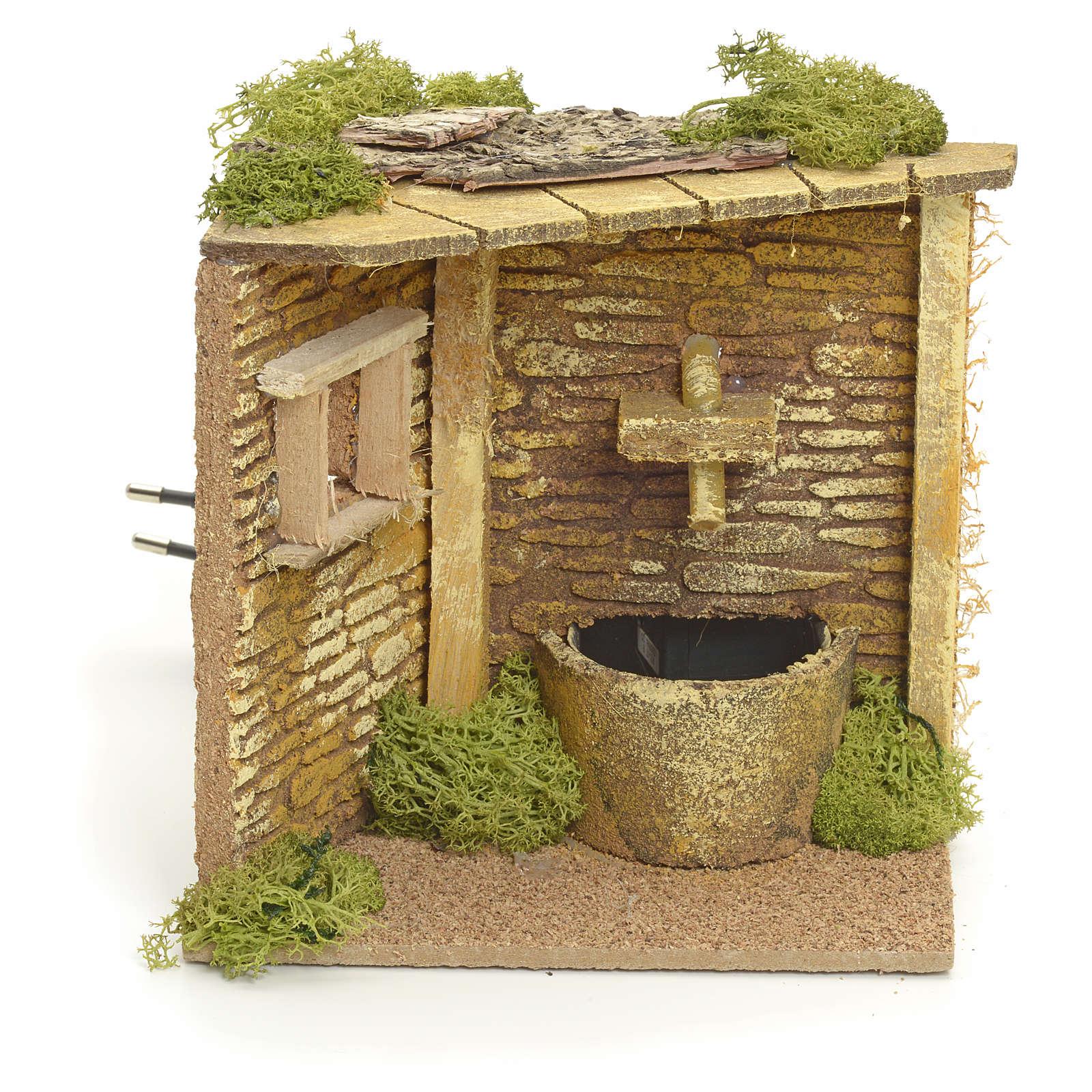 Coin de maison avec fontaine électrique crèche 4