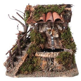 Fontaine dans la roche avec toit pour crèche s1