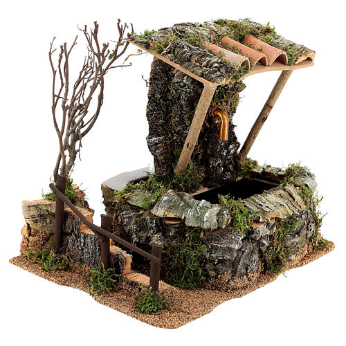 Nativity setting, fountain in the rocks with roofing 3