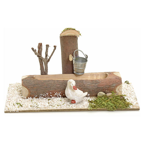 Nativity setting, fountain in the log 1