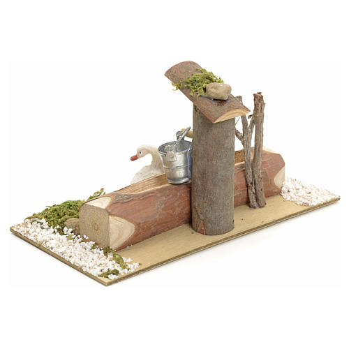 Nativity setting, fountain in the log 3