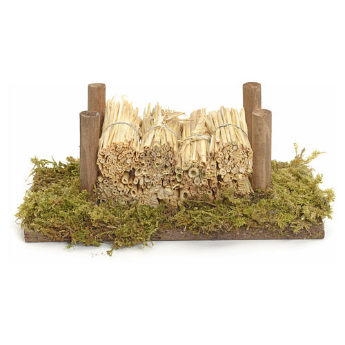 Nativity accessory, wood stack on moss with straw 1