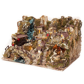 Nativity village with fire, lights, waterfall and pond 56x76x48c s3