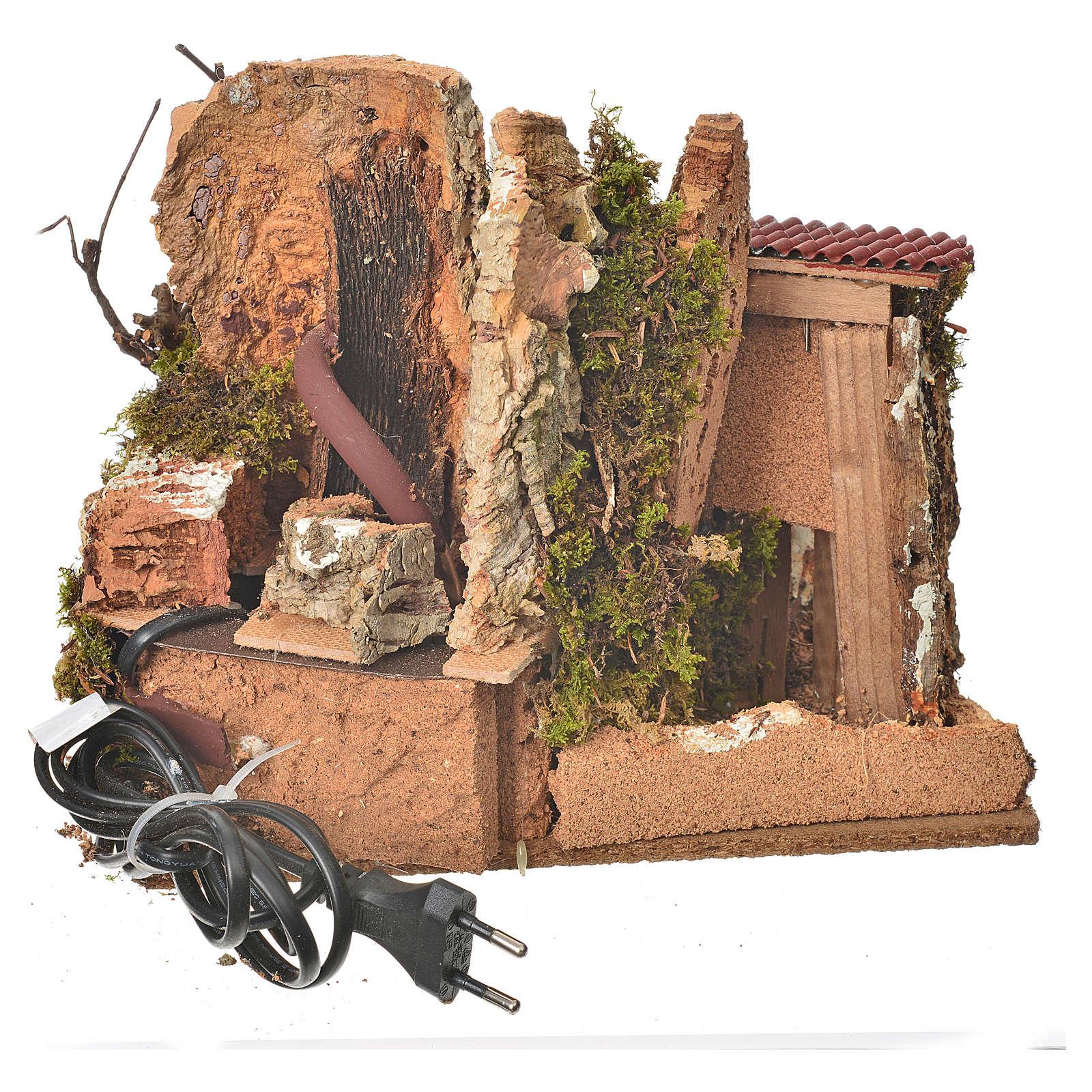 Fuente en la roca con casa, escenografía belén 4