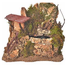 Fuente en la roca con casa, escenografía belén s1