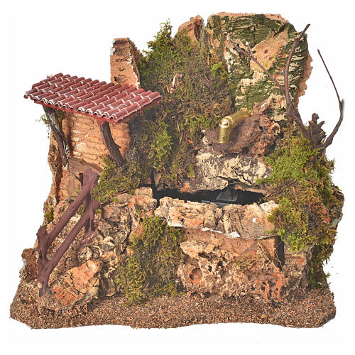 Nativity fountain in the rocks with house, setting 1