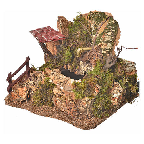Nativity fountain in the rocks with house, setting 2
