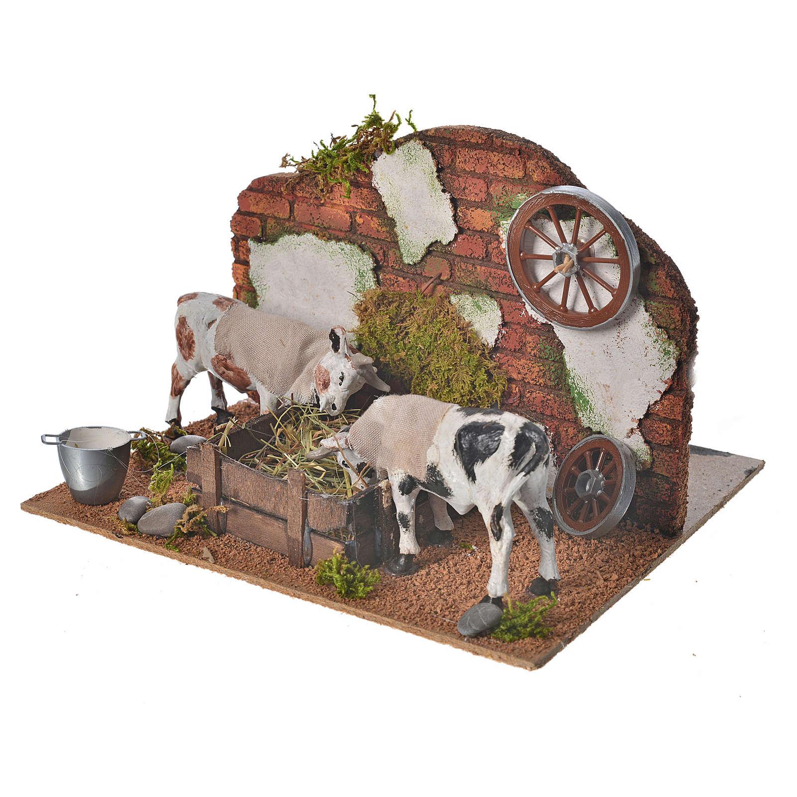 Mucche alla mangiatoia 10 cm ambientazione presepe movimento 4