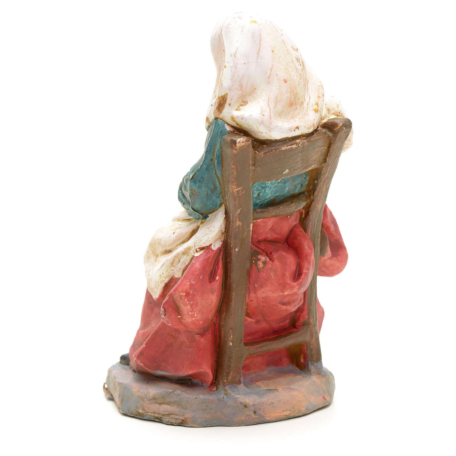 Nativity set accessory, Woman sitting with pan figurine 3