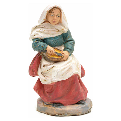 Nativity set accessory, Woman sitting with pan figurine 1