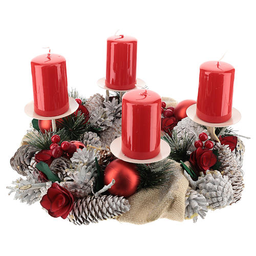 Snowy advent wreath with red berries and red candles 1