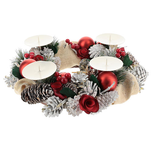 Snowy advent wreath with red berries and red candles 2