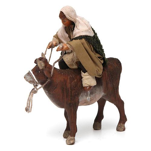 Nativity set accessory Countryman on ox 10 cm figurine 2